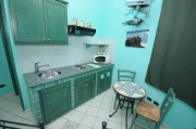 Green kitchenette one-room flat